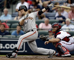 Nella foto Buster Posey (By Chris Saur)