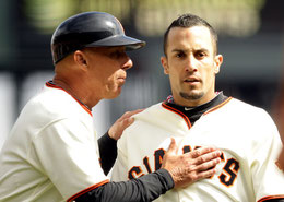 Nella foto il coach Tim Flannery da indicazioni a Andres Torres (Ezra Shaw/Getty Images North America)