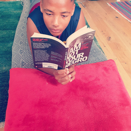 Melchior Hughes engrossed in reading