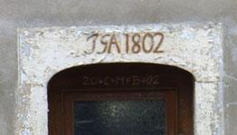 Grundmühle Liegau, Bäckerhaus. Türstein des 1802 von Johann Gottlieb Arnoldt erbauten Bäckerhauses