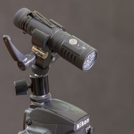 ACEBEAM EC-65 with clamp mount, plugged into the camera flash mount