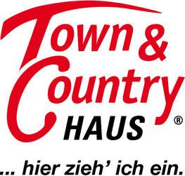 Logo Town and Country hier zieh ich ein Hausbaufirma