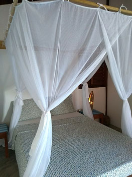 Bedroom with moskito net