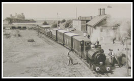 Talyllyn Railway: A train just leaving Towyn Wharf station.