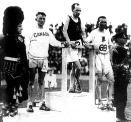 Dunky Wright receiving Scotland's first-ever gold medal at the 1930 Games.