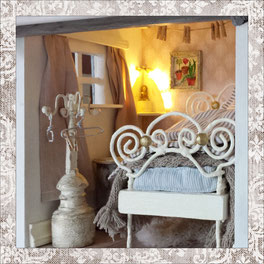 attic room with huge bed, hand stiffed mattress, all in shabby white, baby blue and greige with an illuminated buddha altar in the corner