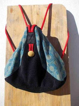 All-In-One-Taschen-Rucksack in schwarz, türkis (Stoff Orakelblume) mit roten Trägern/ Griffen