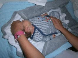 Polariteitsmassage bij een prematuur geboren baby.