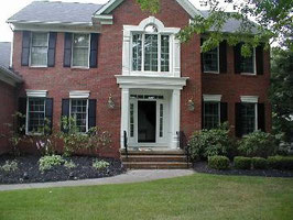Potomac - Painting of exterior trim, windows, doors, iron railings and shutters.