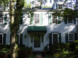 Bethesda - Painting of exterior trim, wood siding, windows and shutters.