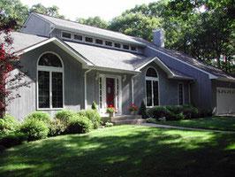 Potomac - Painting of trim, cedar siding, windows and garage door.