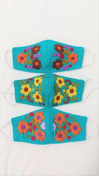 Farbenfrohe Boho Alltagsmaske (türkis-Naturtöne)