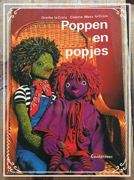 Het boek 'Poppen en popjes' van Grethe la Croix