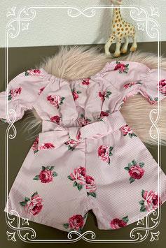 Leuke roze jumpsuit met bloemen maat 80