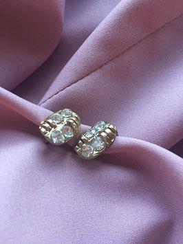 Nieuwe goud kleurige oorbel met glitter steentjes