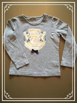 Een grijs shirtje van Disney - maat 104