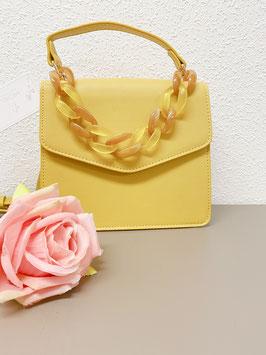 Nieuw: Okergeel handtasje met ketting van Michelle