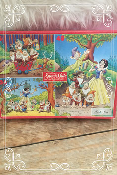 Drie puzzels van Disney Sneeuwwitje en de zeven dwergen