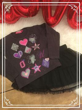 Opvallend shirt met zwarte rok van New Basic - Maat 104/110