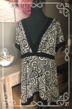 Zwart/witte tuniek met bloemenprint - Maat L