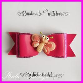 Een roze strik met een leuke vlinder