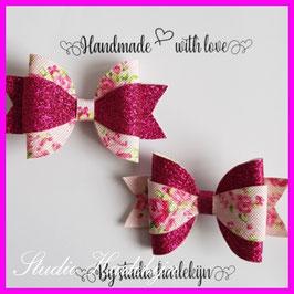 Twee haarstrikken glitter roze/bloemen