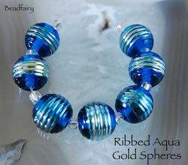 7 Ribbed Aqua Gold Spheres