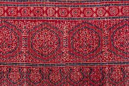 A. Couvre-lit rouge de Barmer