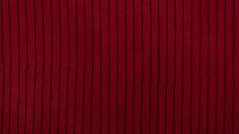 Rayures noires sur un rouge franc