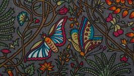 Papillons bleus sur un ciel lie de vin