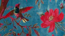 Oiseaux de paradis sur un velours turquoise