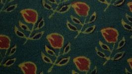 Petite fleur rouge à quatre feuilles