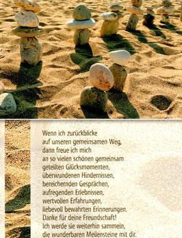 Steine im Sand - Meilensteine