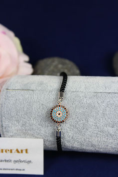 Armband mit Zwischenteil aus Silber rotvergoldet türkis färbig mit schwarzer Samtkordel