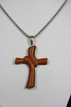 Elegant geschwungenes Holzkreuz aus dem Holz des Zwetschkenbaumes