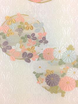紗袋帯唐織白地花丸紋