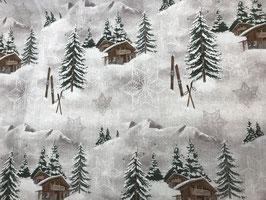 Schöner Stoff mit Wintermotiv Ski und Chalet in den Bergen