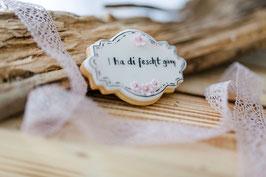 Cookie in Etikettenform mit dezenter Zuckerdekoration und Wunschtext