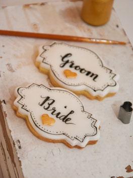 Cookie beschriftet mit Bride oder Groom