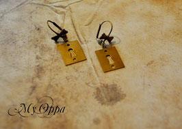 Boucles d'oreilles cadenas avec noeud
