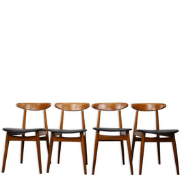 Suite de 4 chaises années 60 en teck et simili cuir noir