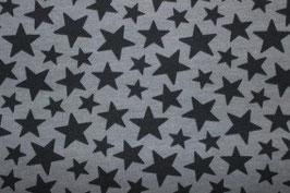 Schwarze Sterne auf grau