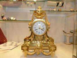 Pendule bronze dorée