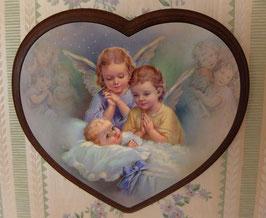 Deux anges veillent sur bébé