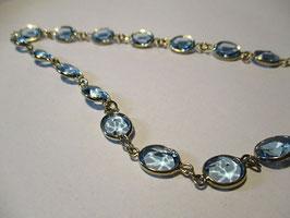 Collana argento placcato oro e topazi azzurri