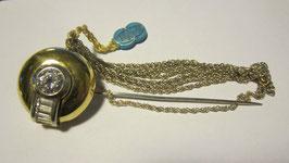 Spilla in argento placcato con zircone centrale