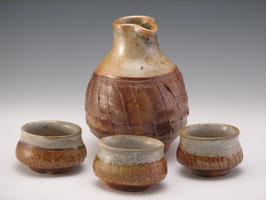 Sake set.  Wood fired 4 piece set.