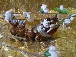 kleiner Rentierschlitten mit Santa
