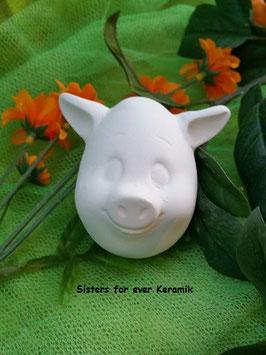 Schweineei lächelnd