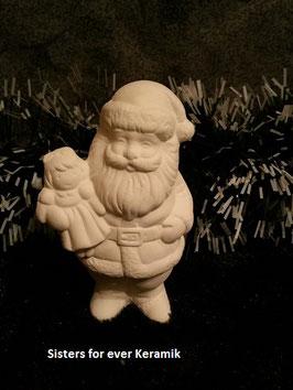 Kleiner Weihnachtsmann mit Puppe